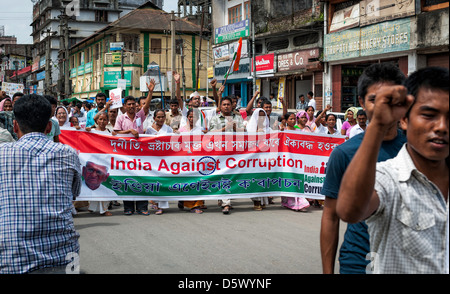 People with large banner and Indian flag demonstrate in favour of politician Anna Hazare and against corruption - Stock Photo