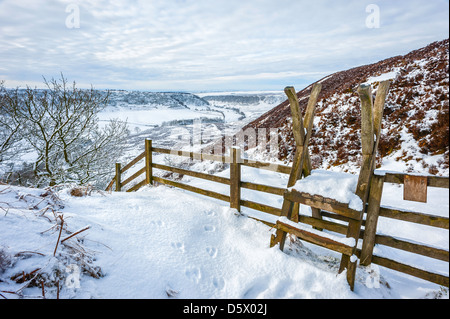 Rambler gate leading to Hole of Horcum on a beautiful winter landscape covered in snow near Goathland, Yorkshire, - Stock Photo