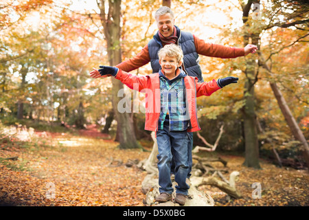 Man and grandson playing in park - Stock Photo