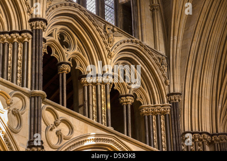 Pointed Gothic stone masonry arches in Angel Choir of Lincoln Cathedral, Lincolnshire, England, UK - Stock Photo