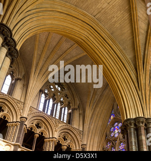 Pointed Gothic masonry arches, stone pillars and vaulted ceilings, Lincoln Cathedral, Lincolnshire, England, UK - Stock Photo