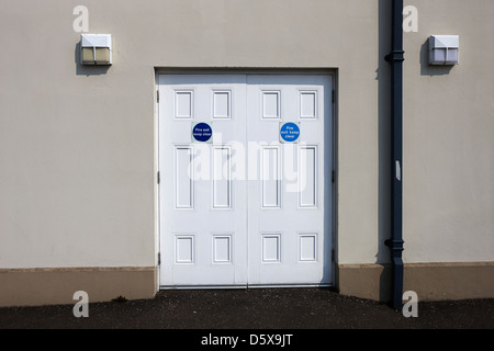 fire exit keep clear emergency doors in a public access building moira county down northern ireland uk - Stock Photo