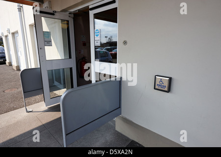 press to open disabled automatic door access to a public building northern ireland uk - Stock Photo