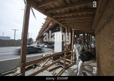 March 25, 2013 - Los Angeles, California, U.S - A pedestrian walks by the construction site of the Metro Expo Line - Stock Photo