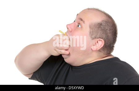 Fat Man Greedily Eating French Fries - Stock Photo