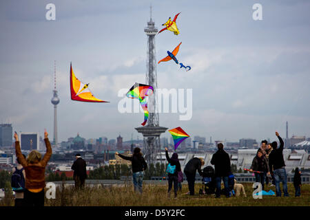 Numerous people let their kites fly on Teufelsberg (lit. Devil's Mountain) in Berlin, Germany, 07 October 2012. - Stock Photo