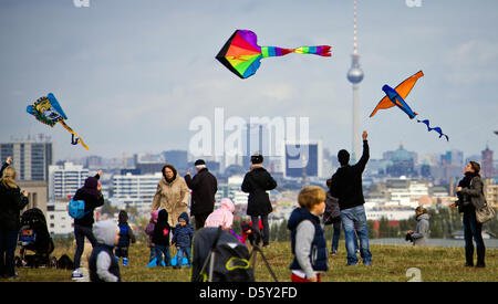 Numerous people let their kites fly on Teufelsberg (lit. Devil's Mountain) in Berlin, Germany, 07October 2012. - Stock Photo