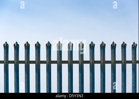 Security Metal Fence Against a blue sky - Stock Photo