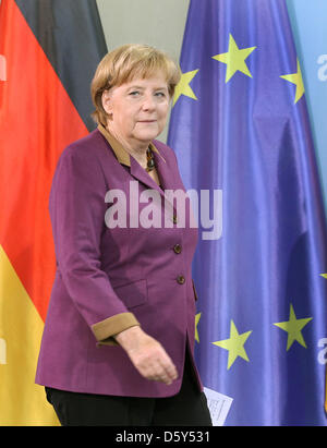 German Chancellor Angela Merkel walks to a press conference to deliver a statement on the Nobel Peace Prize 2012 - Stock Photo