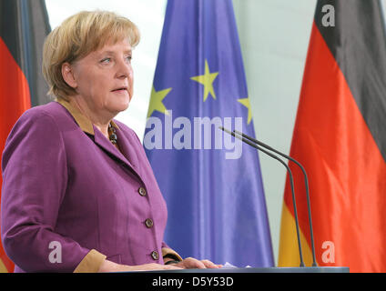 German Chancellor Angela Merkel delivers a statement on the Nobel Peace Prize 2012 at the Chancellery in Berlin, - Stock Photo