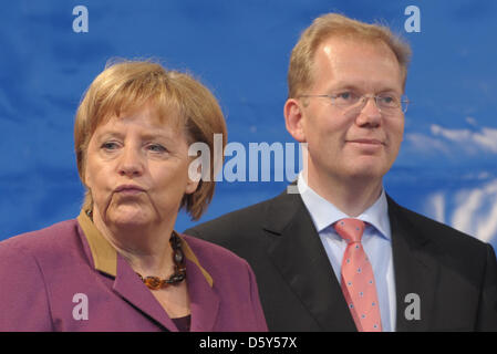 German Chancellor Angela Merkel (CDU) stands next to independent candidate for mayor, Sebastian Turner, on a stage - Stock Photo