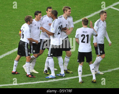 Germany's Mesut Oezil (2nd L) celebrates with team mates after scoring the 4-0 goal during the FIFA World Cup 2014 - Stock Photo
