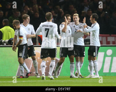 Germany's Miroslavklose (3rd R),Marcoreus (2nd R) and Mesut Oezil celebrate after scoring during the FIFA World - Stock Photo