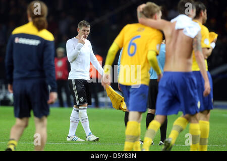 Germany's Bastian Schweinsteiger (2nd, l) looks dejected after the FIFA World Cup 2014 qualifying soccer match between - Stock Photo