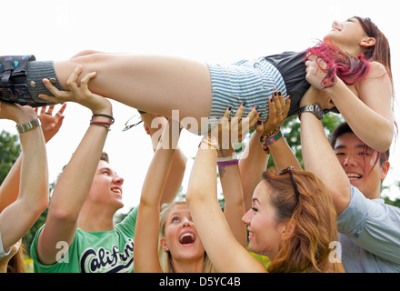 Teenagers Crowd Surfing at Music Festival - Stock Photo