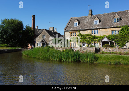 Cotswold cottages and the Old Mill on the River Eye - Stock Photo