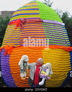 Baerbel Wohlleben poses in front of a gigantic Easter egg in her garden in Croelpa-Loebschuetz, Germany, 05 April - Stock Photo