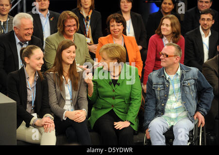 German Chancellor Angela Merkel sits next to citizens attending the second citizens' dialogue in Heidelberg, Germany, - Stock Photo
