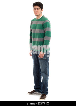 Full length portrait of young man with hands in pockets isolated on white background - Stock Photo
