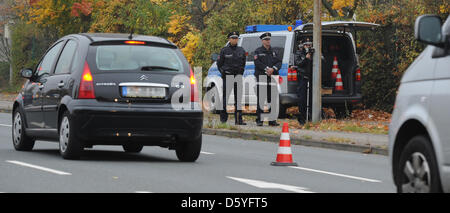 Police officers use a laser speed measuring device in Hanover, Germany, 24 October 2012. Police will carry out speed - Stock Photo