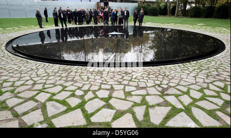 Guests view the memorial to the Sinti and Roma murdered under National Socialism in Berlin, Germany, 24 October - Stock Photo