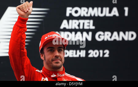 Spanish Formula One driver Fernando Alonso of Ferrari seen on the podium after winning the second place during the - Stock Photo