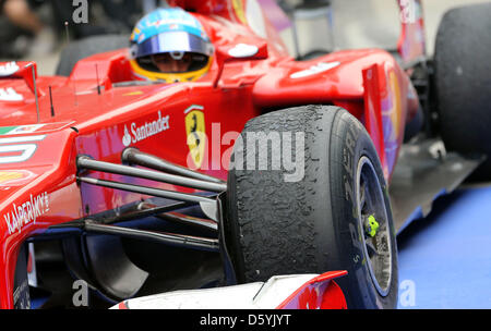 The race tires are seen on the car of Spanish Formula One driver Fernando Alonso of Ferrari after the Formula One - Stock Photo