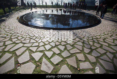 Visitors are pictured at the newly opened memorial for Sinti and Roma who were murdered by the Nazis at the Tiergarten - Stock Photo