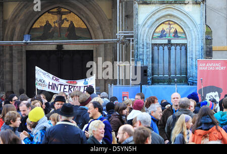 Numerous people celebrate Reformation Day in front of the door of All Saints' Church (Castle Church) to which Luther - Stock Photo