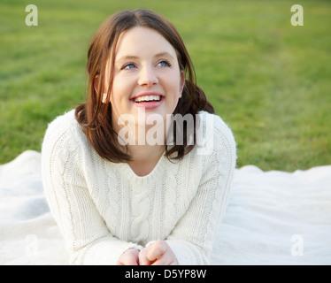 Teenage Girl Lying on Grass - Stock Photo