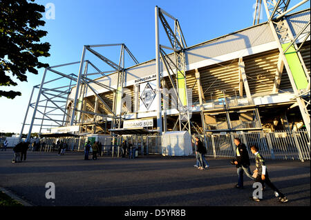 Soccer fans arrive at the Borussia Park soccer stadium to watch the Europa League match between Borussia Moenchengladbach - Stock Photo