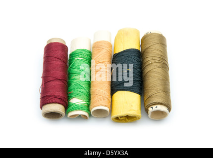 old thread spools isolated on white background - Stock Photo