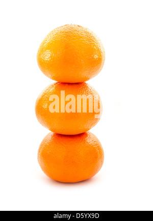 pile of oranges isolated on white background - Stock Photo