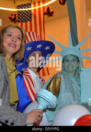 Bavarian Minister of Justice Beate Merk poses with stilt artists dressed as Satue of Liberty and Uncle Sam as they - Stock Photo