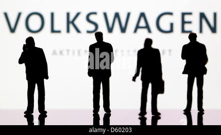 (ILLUSTRATION)An illustration dated 09 November 2012 shows small plastic figures in front of the logo of the DAX - Stock Photo