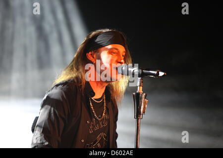 Nic Maeder, lead singer of the Swiss band Gotthard performs on stage at the city hall in Langen, Germany, 9 November - Stock Photo