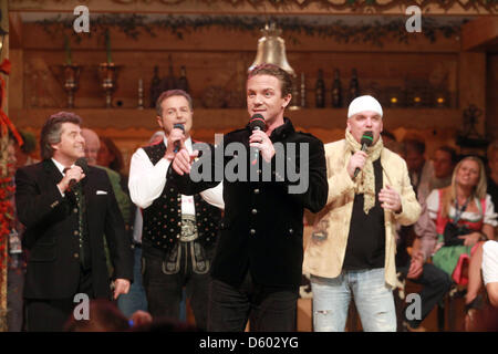 The traditional folk music stars Andy Borg, Norbert Rier, Stefan Mross and DJ Oetzi (l-r)are pictured on stage during - Stock Photo