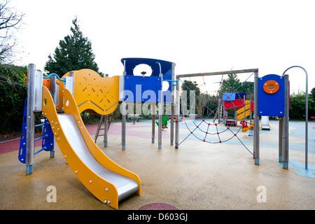 Slide climbing web in children's playground - Stock Photo