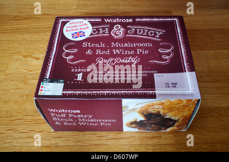 Beef Steak Pie With A Puff Pastry Crust Top And Chips On A ...