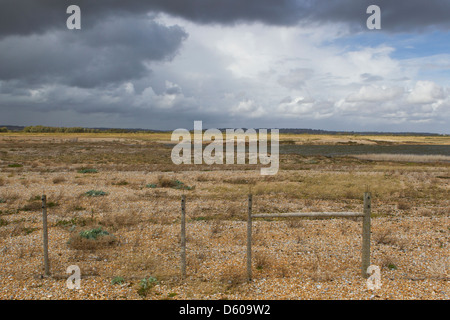 Landscape view of shallow lagoons surrounded by shinge, Rye Harbour nature reserve, East Sussex, UK in September - Stock Photo