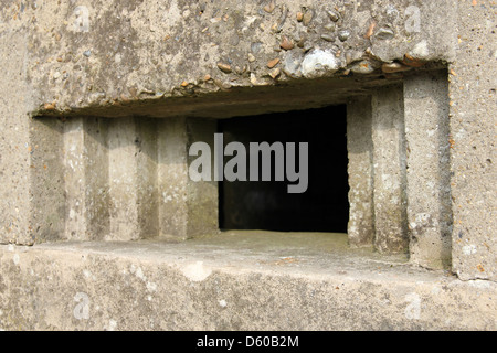 window, gun slot concrete pillbox bunker and look out as part of world war two coastal defenses along Suffolk's - Stock Photo