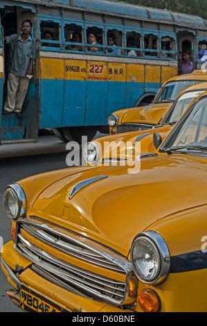 a row of taxis and a bus, kolkata, india - Stock Photo