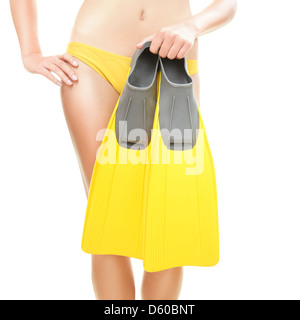 Closeup of woman holding swimming fins / flippers going snorkeling isolated on white background - Stock Photo