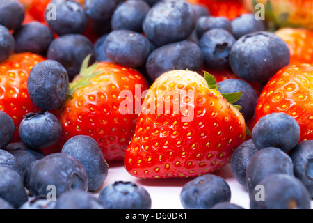 Heap Fresh Strawberries and Blueberries - Stock Photo