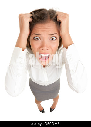 Funny image of young Caucasian Asian businesswoman frustrated and stressed pulling her hair isolated on white background - Stock Photo