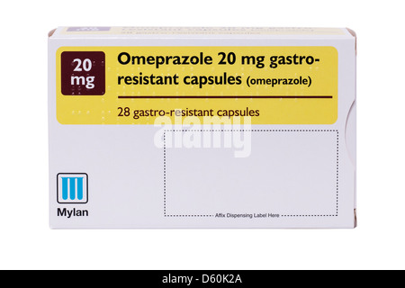 A box of Omeprazole 20 mg gastro-resistant capsules on a white background - Stock Photo