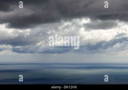 Stormclouds over Frenchmans Bay, Maine, with rain in the distance. - Stock Photo