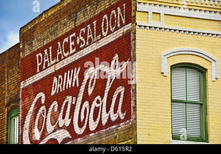Historical Coca Cola sign painted on brick exterior of Palace Saloon, Centre Street in Fernandina Beach, Amelia - Stock Photo