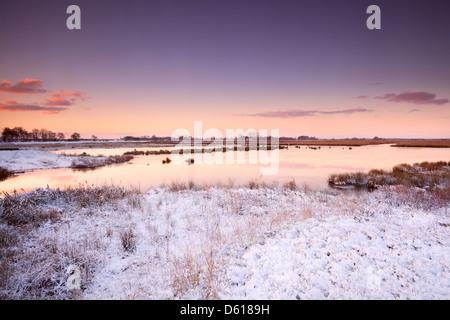 sunrise over river in winter - Stock Photo