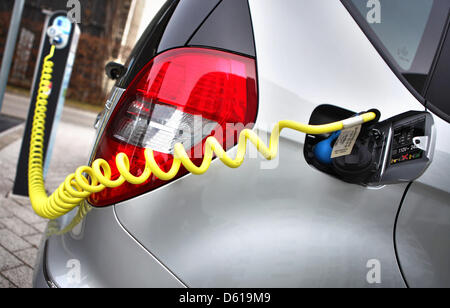 FILE - A file picture dated 05 March 2012 shows a Mercedes electric car being charged in Halle (Saale), Germany. - Stock Photo